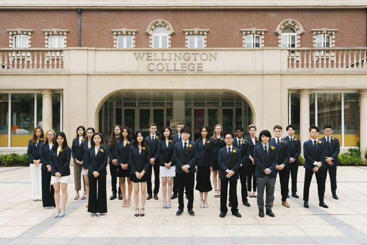 Wellington College students in front of school
